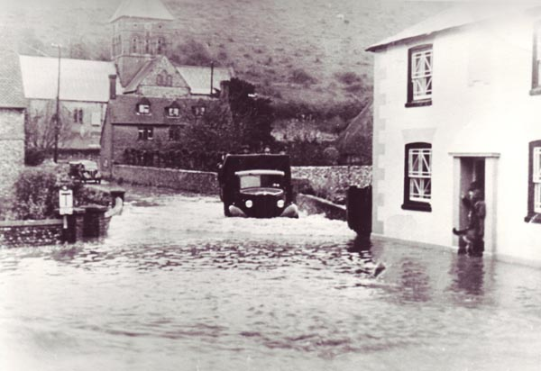 Truck makes its way down Church Street during flood in 1950s