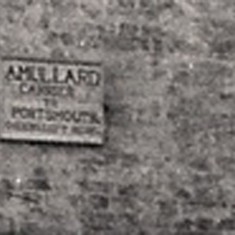The sign reads 'A Mullard, Carrier to Portsmouth'. His competitor, Noble White, lived just 100 yards down the High Street.