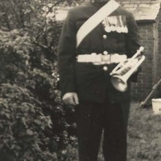 Bugler in uniform. We know that both George Fisher and his son Robert played in the fife and drum band.
