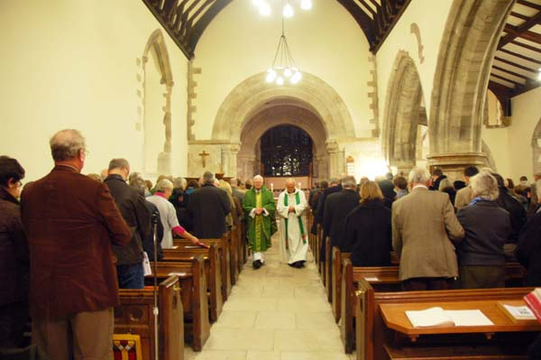 Catholic Canon Gerard Hetherington and Anglican Canon Terry Louden process down the aisle of All Saints after the service. 2013.