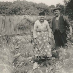 Couple in working clothes in garden