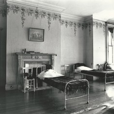 Dormitory at Wesbury House, with original wallpaper from re-building after the fire in 1904.