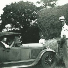Ernest with George Munday 'sweeping'  hay with car