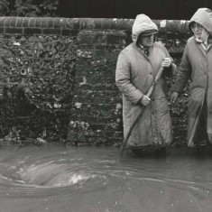 Flooding outside Frogmore Cottage, George (last thatcher in East Meon) & Jean Samways