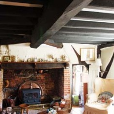 Sitting room with inglenook fireplace (likely to have been installed in the 17th century).