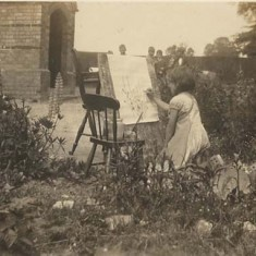 Girl painting in garden