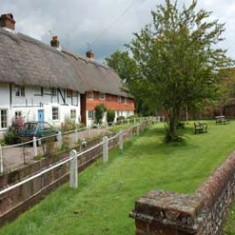 Before the fire. Hockley Cottage, with Brook Cottages beyond.