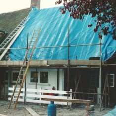 Kitchen roof under tarpaulin during alterations