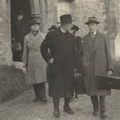 Major Gerald Nicholson, right, outside All Saints Church with visiting bishop. Nicholson  used to walk to church every Sunday, and back via Colchenna where he talked with Ernest Noyce.