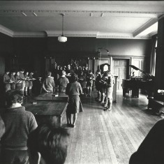 The school at morning prayers in the organ room.