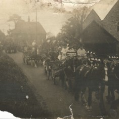 Early photo of procession passing between Court Farm and All Saints.