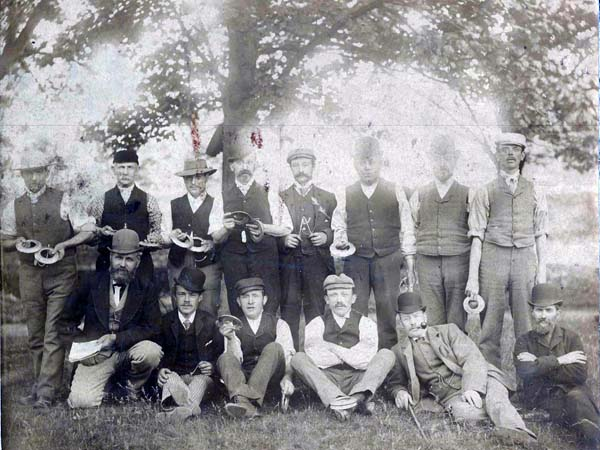 Unidentified men in team photograph. They appear to be holding wooden quoits.