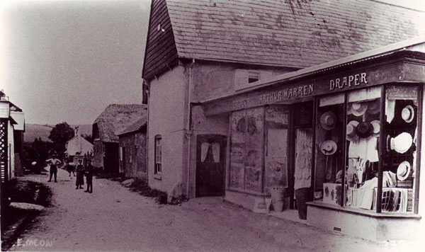 Old postcard of The Tudor House with Arthur Warren's shop.
