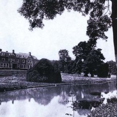 The school buildings from across the lake.