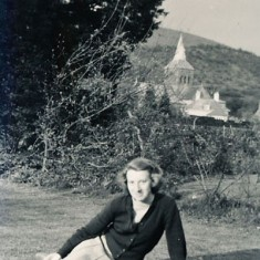 Olivia Woodfield on the lawn at The Tudor House, with a clear view of All Saints' spire behind.