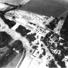 Aerial photograph of the buildings which comprised HMS Mercury. In 1941, Leydene House and 100 acres had been occupied by the Royal Navy, whose Signal School in Portsmouth had suffered from heavy bombing. A Wardroom annex was constructed to the south of the Main House, known as Siberia Block. A large Nissen hut was completed in July 1943 and was used as a cinema, theatre and assembly hall, followed by other training facilities and accommodation.