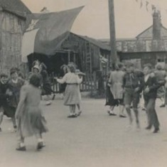 Children dancing in the Square during coronation festivities.