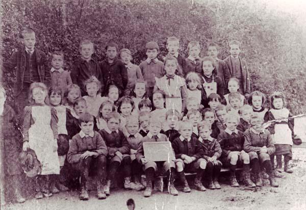 Group of schoolchildren, boy with slate