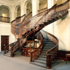 Lady Peel had engaged Hooydonk Brothers to design Leydene; described as 'Decorative Artists', they had created elaborate interior schemes for homes of the 'moneyed classes'. Their most notable contribution was the double-spiral staircase in the spacious entrance hall.