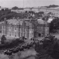 Main house in 1950s, with naval parade taking place in front of it. The first semi-permanent buildings to be constructed commenced in April 1944 and were the classrooms of North Camp.. The Navy requisitioned the property in 1945 and bought Leydene House in 1949.