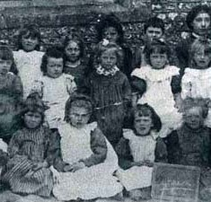 Schoolgirls c 1900. Back row, left to right: Isabel Budd, Miriam Nash, Mabel Pollard, May Kille, Dorothy Kille, Winnie Moody, assistant teacher Frida Kille. Middle row, Unknown, Lily WIlks, Kate Blackman, Nancy Micklam, Winnie Smith, Miriam Sawyer, Ellen Chivers. Front row: Beatrice Parfit, Emily Nicholson, Nellie Hockley, Rose Nicholson, Annie Moon, Nellie Moon.