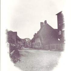 Vignette of High Street. This appears to have been photographed before the 1910 fire which devastated this end of the High Street.