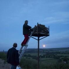 Bill Tyrwhitt Drake about to light the beacon