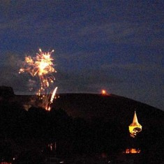 Fireworks, beacon and church tower