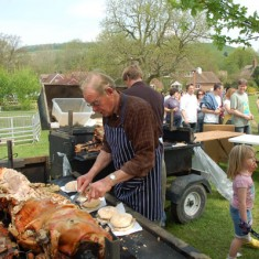 Local farmer Frank Moffatt carving the hog roast, which is provided by another farmer, Matt Atkinson.