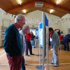 House History panels, History Group member Tony Norman viewing.