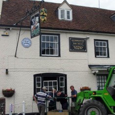 George facade and cherry picker, installing village broadband 2002. The wireless aerial  is being attached to the chimney at the George.