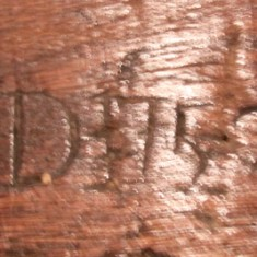 The initials 'RD' carved on mantel beam, probably standing for Richard Dance.
