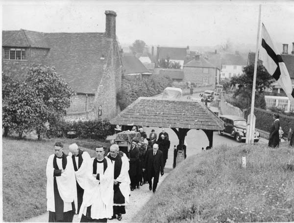 Wartime funeral procession, led by Rev Frederick Saunders, left.