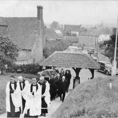 The Rev Saunders (left) leading funeral procession