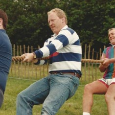Rory Bremner, then living in East Meon, invited Scottish International rugby players to join his team in the tug-of-war
