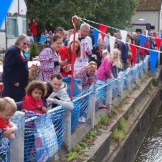 Spectators along river