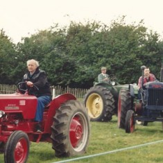 Parade of vintage tractors at an early Country Fair.