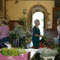Flower arrangers by the West door of All Saints,
