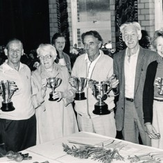 Garden Club Annual Show in Village hall, cup winners. On left, Admiral Dennis Mason, on right, Paddy Mason and Jane Atkinson.