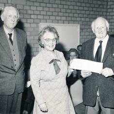 Mrs Tucker makes presentation to Herbie Goddard (right)