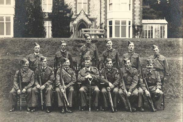The Commanding Officer (Frank Collyer) and the NCOs of the Home Guard.