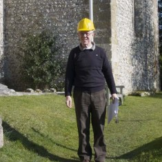 Martin Harbord with hard hat and papers