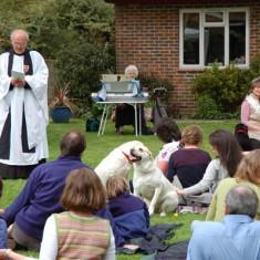 Outdoor pets' service in garden of Vicarage.