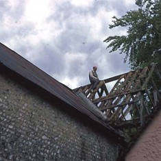 Denys sawing one of the rafters as part of the reconstruction of Frogmore Mill