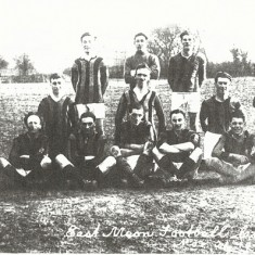 Early team. Goalie Caleb Kille, L. Back W. Nicholson, Ctr Half, P.C.Parminter, L Half, Bill Budd, Outside right Dido Moore, Inside Right, Chris Budd, Ctr Forward Joe Atkinson, Outside Left, Darkie Nicholson. With box, Mr Crockford, With flag, Mr Flux