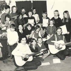 Little Folk singing group. Nigel Lambert with guitar, front right. Bridget Lambert third from left, back row. February 1969.