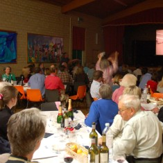 Race  night in Village Hall, fundraising for Cricket Club. Wilson Atkinson on R.