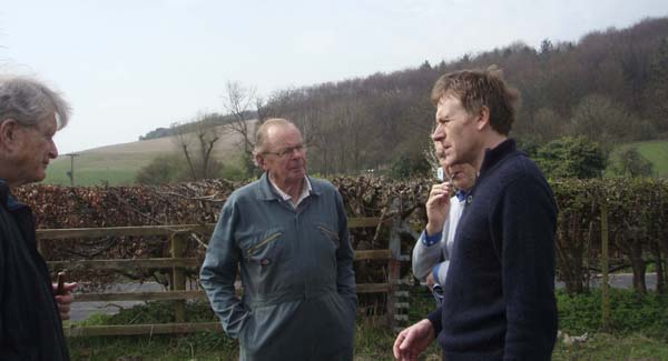 Guy Liardet, chair of Saxons project, discussing with Frank Moffatt, farmer, Michael Blakstad, EMHG, and Dr Nick Stoodley, lead archaeologist, a possible site for a geophysical survey near East Meon
