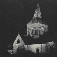 Post card of All Saints at night.