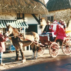 Cart with Fr Xmas outside Riverside Stores and Post Office